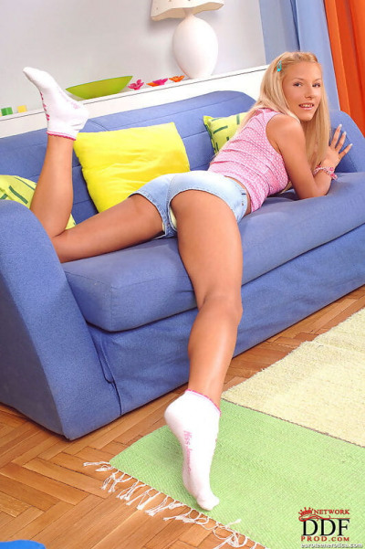 Sweet blonde Eve Jordan removes cotton underwear to toy teen pussy in socks