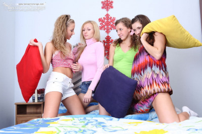 Young girls gather on a bed for a lesbian foursome after classes are out