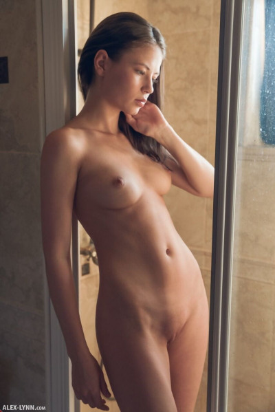 Naughty brunette Hilary washes her beautiful naked body in the shower