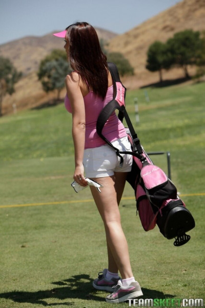 Lush brunette Carina Roman goes golfing then strips indoors and spreads thighs