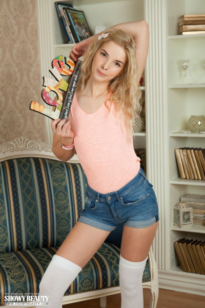Sweet teen Moon rolls off white hosiery to model totally naked