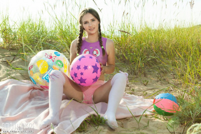 Petite teen Lit shows her tight ass and twat on a sandy beach dune